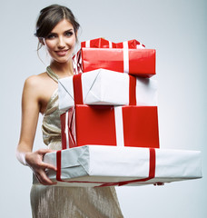 Young woman hold many red, white gift box . Female model isolat