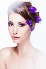 Fashion Beauty Model Girl with Flowers Hair. Bride. Perfect