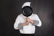 Leinwanddruck Bild - Chef behind pan