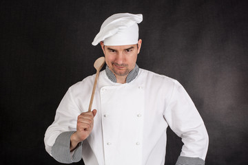 Chef holding wooden spoon
