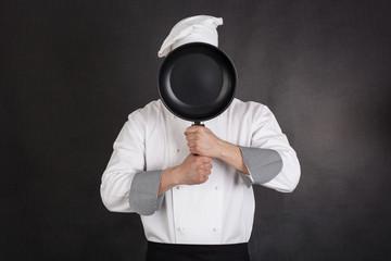 Chef behind pan
