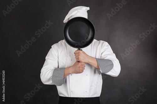 Leinwanddruck Bild Chef behind pan