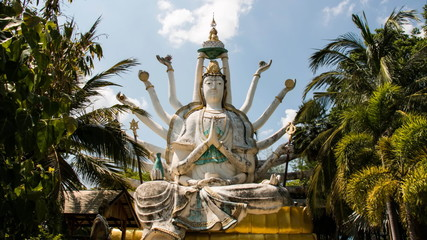 Statue of Guan Yin with timelapse clouds