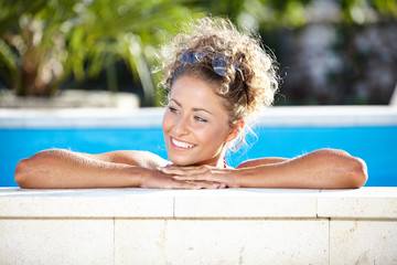 Portrait of a sexy woman relaxing in a swimming pool
