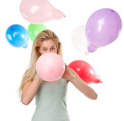 Woman blowing up balloons for a party