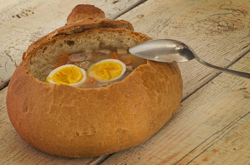 Easter soup with egg and sausage in bread