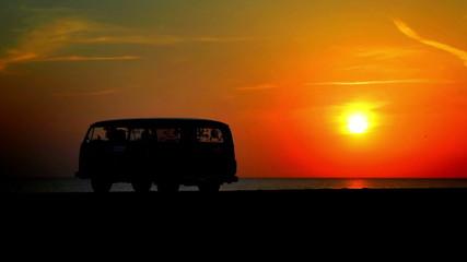 Minibus at sunset