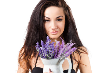 Portrait of young woman taking lavender