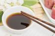 Dumpling Sauce - Chopsticks resting on a bowl of asian sauce