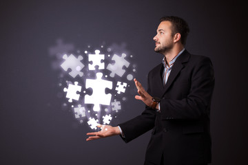 Puzzle pieces in the hand of a businessman