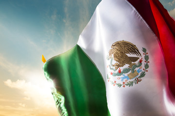Mexican flag against a bright sky, independence day, cinco de ma