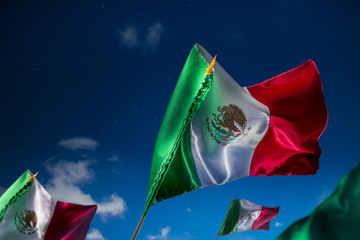Mexican flags against a night sky, independence day, cinco de ma