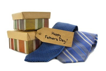 Happy Fathers Day tag with gift boxes and ties over white