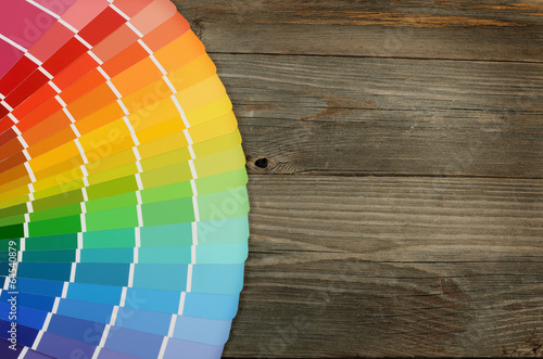 Color palette on the wooden background - 64540879