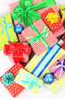 Many colorful presents with luxury ribbons
