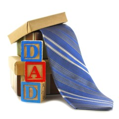 DAD toy blocks with gift boxes and ties over white