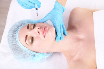 Woman in beauty clinic getting botox injection,