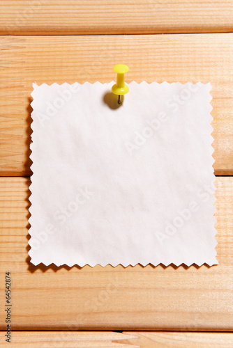 Empty paper sheet on wooden background