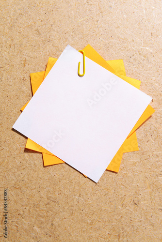 Empty paper sheets on wooden background