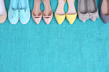 Female fashion shoes on blue carpet