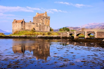 Famous Eilean Donan Castle of Scotland with reflections