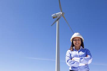 Beautiful engineer standing at wind farm