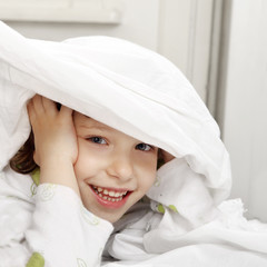 Happy child in the bed