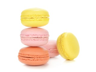 A stack of traditional french macaroons on a white background