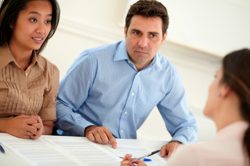 Ethnic couple interested in a contract