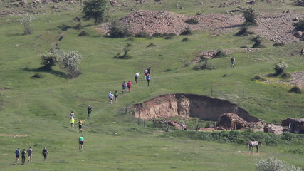 Runners set off on a mountain marathon