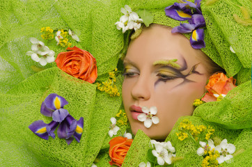 Portrait of beautiful woman in flowers