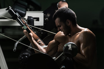 Young Man Doing Exercise For Biceps