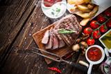 Fototapety Beef steak on wooden table