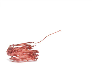 Thin spool of copper electrical bent wire isolated on white