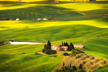 Pienza, rural sunset landscape. Countryside farm and green field