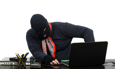 Thief inserting usb flash memory into laptop
