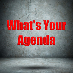 What's Your Agenda concrete wall