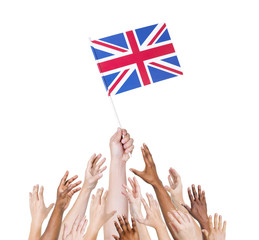Multi-Ethnic People Reaching for and Holding the Flag
