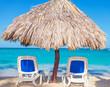 Beach Chairs and Straw Umbrella on the beach