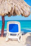 Beach chair and umbrella on  beach