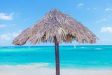 Wooden umbrella on beach