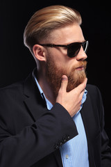 young business man touches his beard