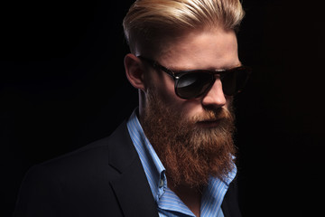 bearded business man looks down