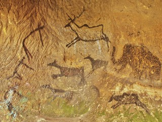 Abstract children art in sandstone cave. Paint of human hunting.