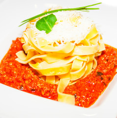 Pasta with meat tomato sauce bolognese, cheese on plate,