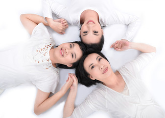 happy family good time lying on the floor with heads together