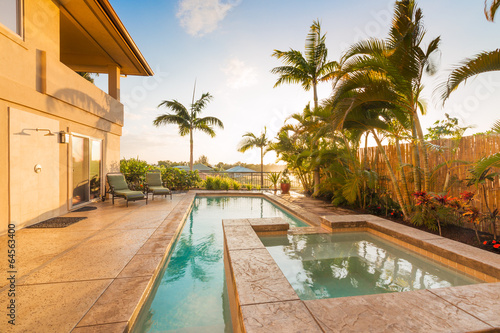 Foto op Canvas Stadion Home with Pool and Hot Tub at Sunset