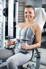 Young woman relaxing in a fitness center