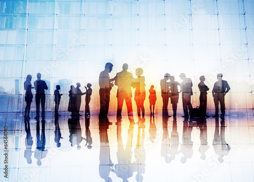 Silhouettes of Business People Discussing Outdoors - 64564040
