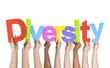 Diverse Hands Holding The Word Diversity